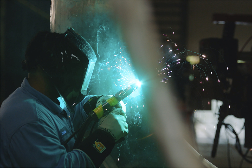 Welder working on LNG heat exchanger at Port Manatee facility
